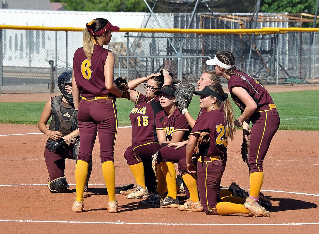 Horace Langford Jr./Pahrump Valley Times Pahrump Valley softball players take a knee in front of pitcher Amaya Mendoza after a Sunrise Mountain player was injured during the Trojans' 15-0 win Thur ...
