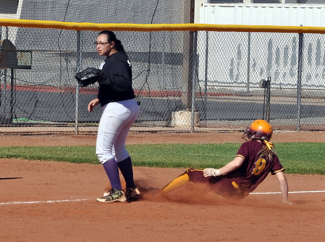 Horace Langford Jr./Pahrump Valley Times Pahrump Valley's Evandy Murphy slides safely into third base during the Trojans' 15-0 win over Sunrise Mountain on Thursday, May 3, in Pahrump.