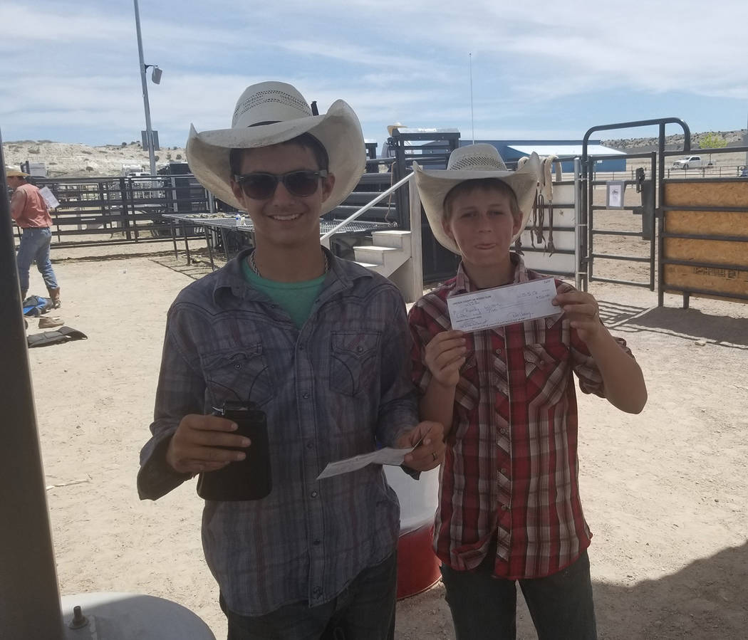 Buddy Krebs/Special to the Pahrump Valley Times Junior Tye Hardy, left, and eighth-grader Randy Witte of Pahrump show off their prizes after last weekend's rodeo hosted by Lincoln County High Scho ...