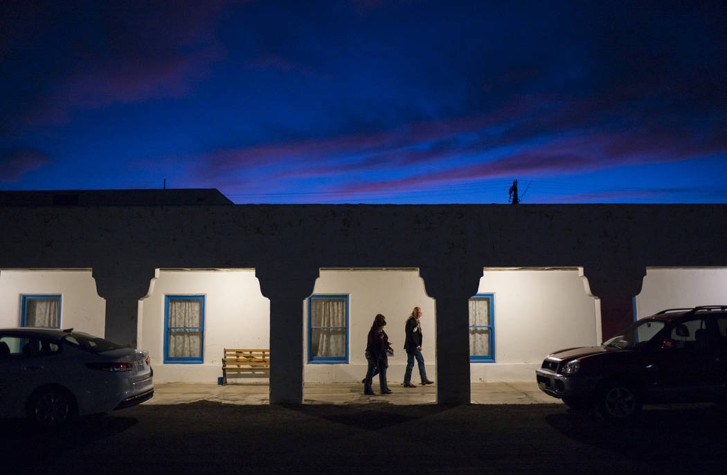 Chase Stevens/Las Vegas Review-Journal Hank Humphreys, a longtime friend of Marta Becket, right, makes his way with others to the Amargosa Opera House for the season-opening performance in Death ...