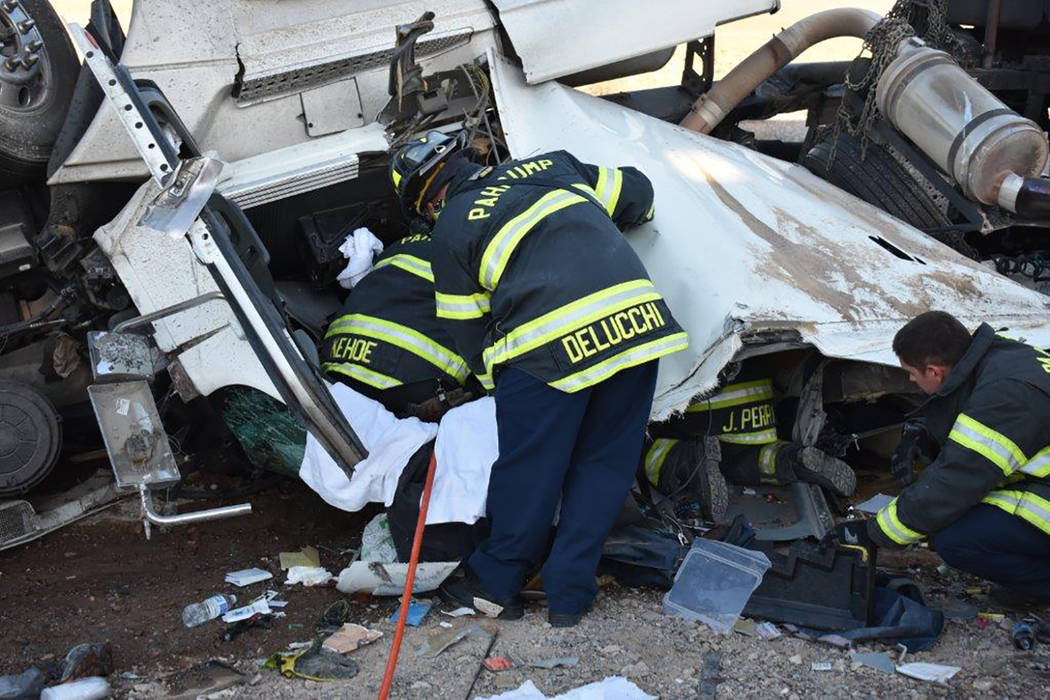 Special to the Pahrump Valley Times Pahrump fire crews worked for several hours to free the entrapped driver of a semi truck which overturned along Highway 127 in Southern Inyo County on Friday mo ...