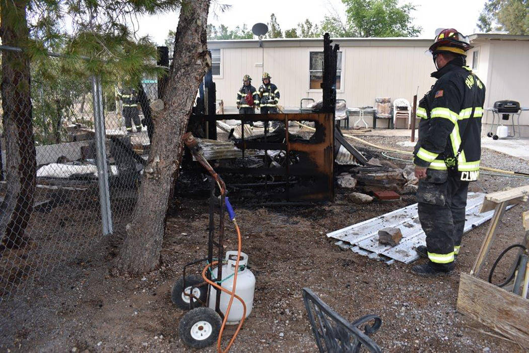 Special to the Pahrump Valley Times Pahrump fire crews assess the aftermath of a structure fire along the 1700 block of Vondell Street on Sunday afternoon. That fire was quickly controlled with no ...