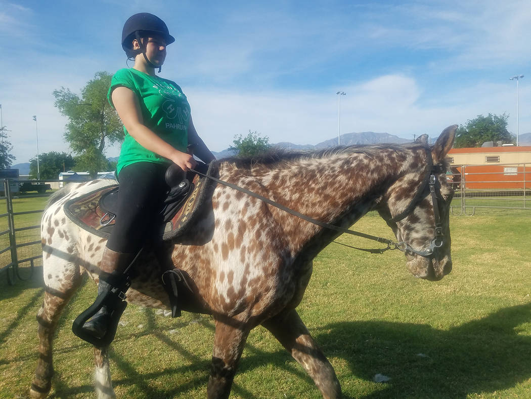 David Jacobs/Pahrump Valley Times Maggie Lepore of 4-H in Southern Nye County rides a horse named Taz as the Wild West Extravaganza and Bluegrass Festival got underway on May 4 in Petrack Park in ...