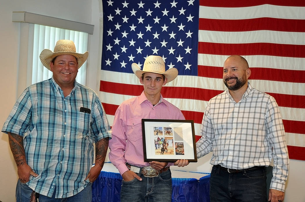 Horace Langford Jr./Pahrump Valley Times Pahrump Valley High School rodeo director Buddy Krebs, left, and junior high rodeo competitor Josh Dobbins of Las Vegas make a presentation to Pahrump Vall ...