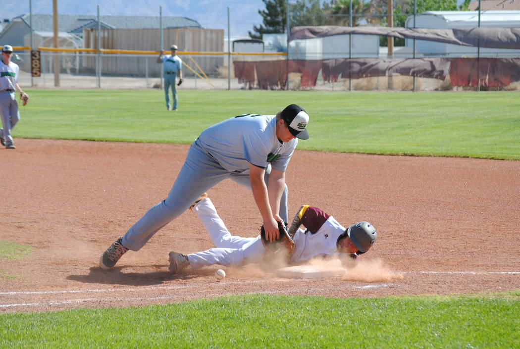 Charlotte Uyeno/Pahrump Valley Times Pahrump Valley's Joey Koenig gets back to first base safely on a pickoff attempt during the Trojans' 6-5 victory over Virgin Valley on Wednesday in the Class 3 ...