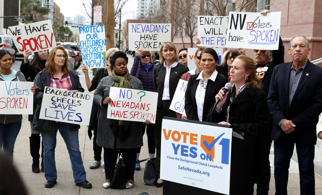 K.M. Cannon/Las Vegas Review-Journal Elizabeth Becker of Nevada MOMs Demand Action speaks with supporters of Question 1 outside the Regional Justice Center in Las Vegas on Friday, Feb. 23, 2018. ...