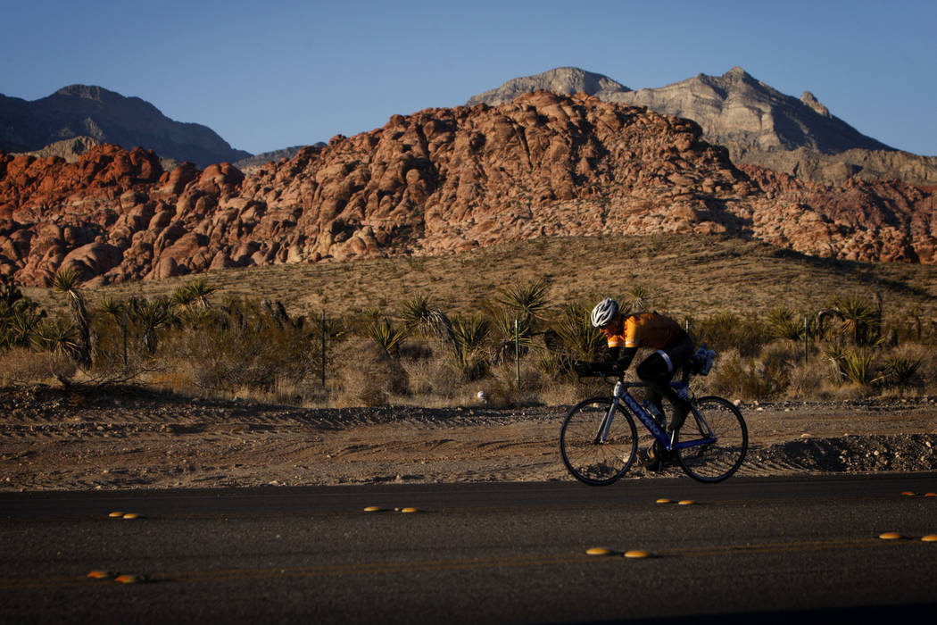 Las Vegas Review-Journal A cyclist rides along State Route 159 in front of Red Rock Canyon National Conservation Area outside Las Vegas in 2011.