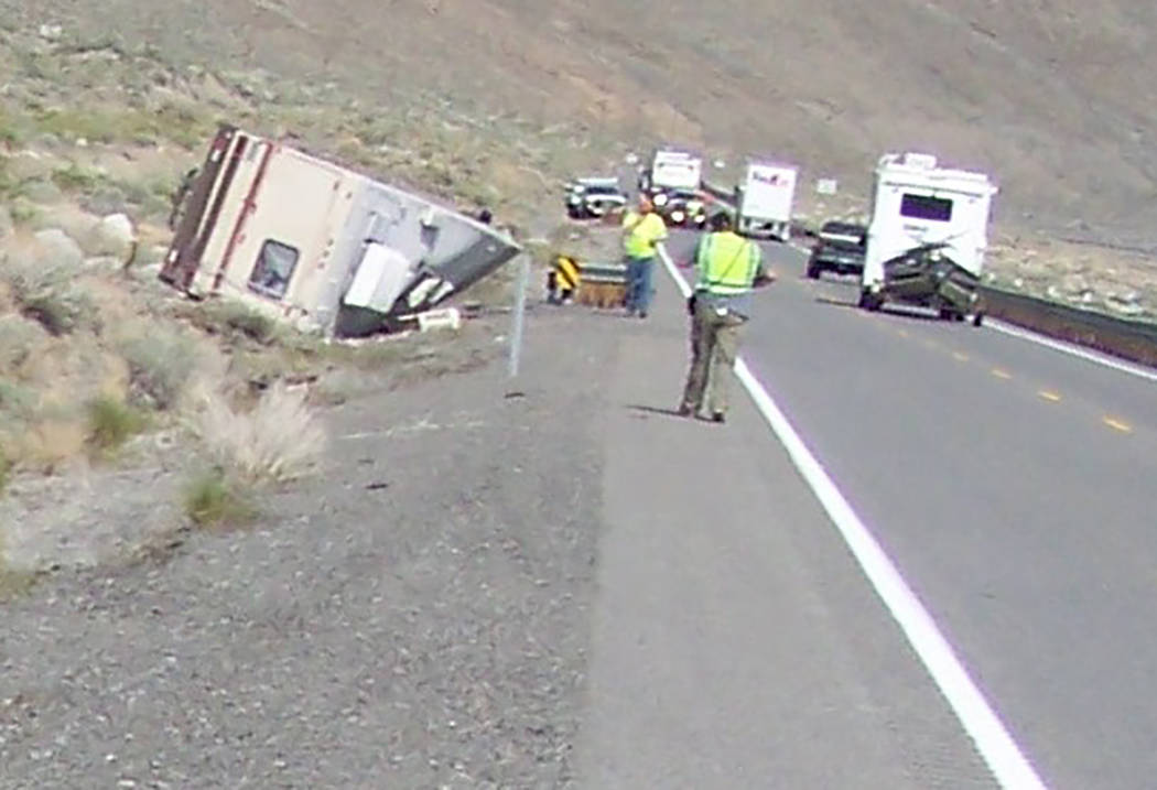 Nevada Highway Patrol Law enforcement works at the scene of a fatal wreck involving a motorhome along U.S. Highway 95 on April 26. The crash, in Nevada's Mineral County, remains under investigation.