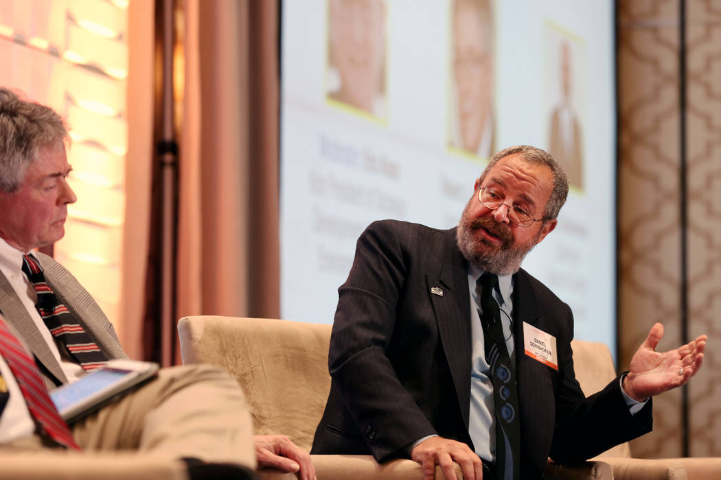 Las Vegas Review-Journal file Nye County Commissioner Dan Schinhofen, right, debates in 2017 with executive director of the Agency for Nuclear Projects, Robert J. Halstead, about the pros and con ...