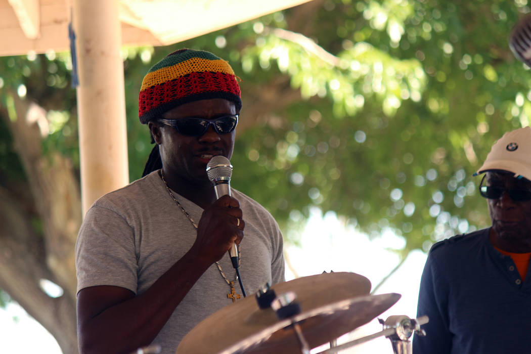 """Jeffrey Meehan/Pahrump Valley Times Stan Rankin T (right) watches performer in local music festival """"One Love,"""" focused on reggae, jazz and other music genres, on May 12, 2018 at Ian Deutch Memori ..."""