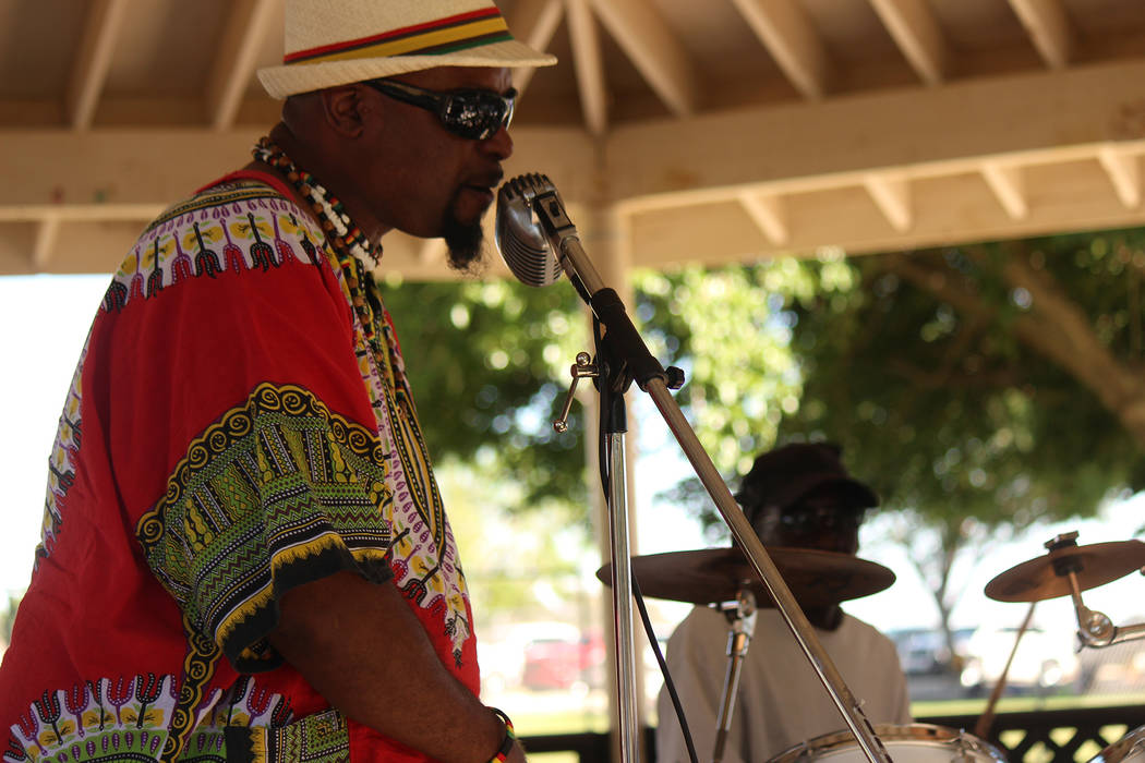 Jeffrey Meehan/Pahrump Valley Times A performer sings reggae-style music at Ian Deutch Memorial Park on May 12, 2018. The sounds of music that found its origins in Jamaica in the late 1960s pulsed ...