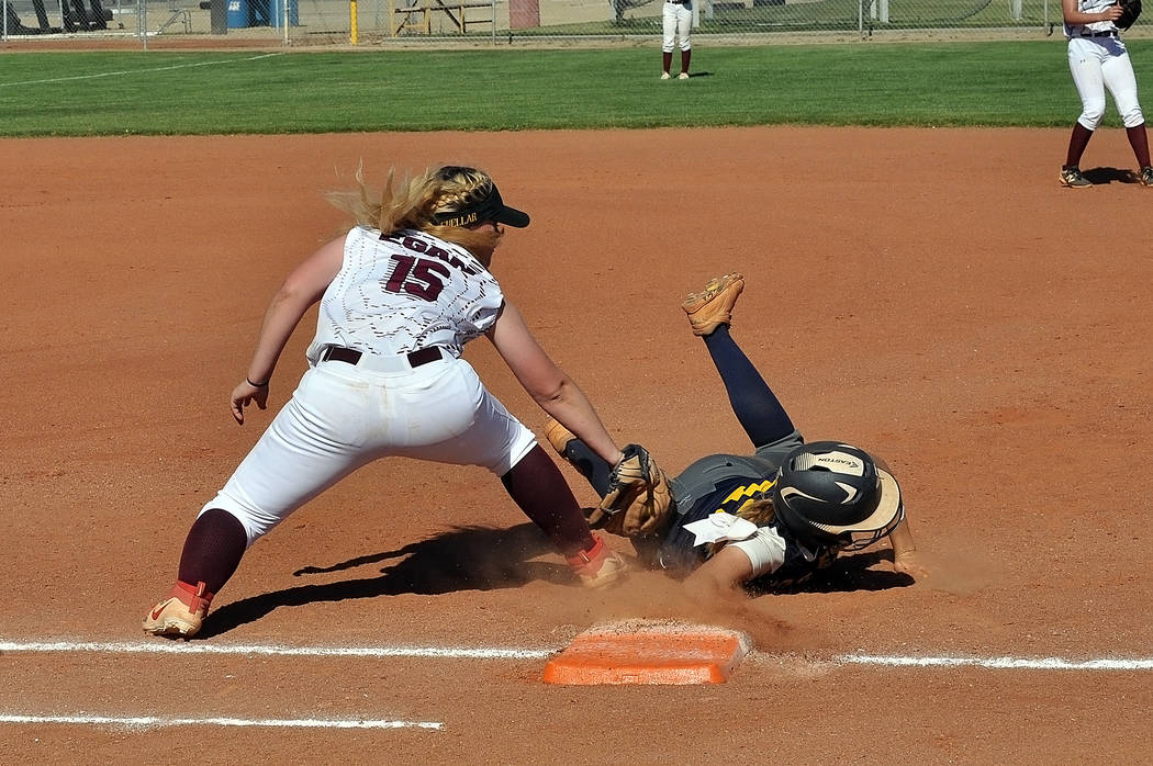 Horace Langford Jr./Pahrump Valley Times First baseman Taylor Egan puts a tag on a Boulder City runner during Pahrump Valley's 15-3 loss to Boulder City in the regional playoffs May 9 in Pahrump.
