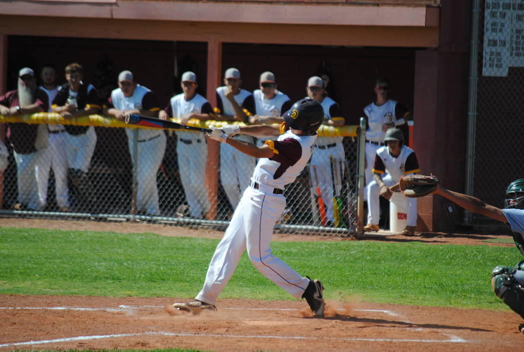 Charlotte Uyeno/Pahrump Valley Times Pahrump Valley junior Dylan Grossell, shown connecting for a hit Wednesday against Virgin Valley, homered during the Trojans' 8-2 loss to Boulder City in the C ...
