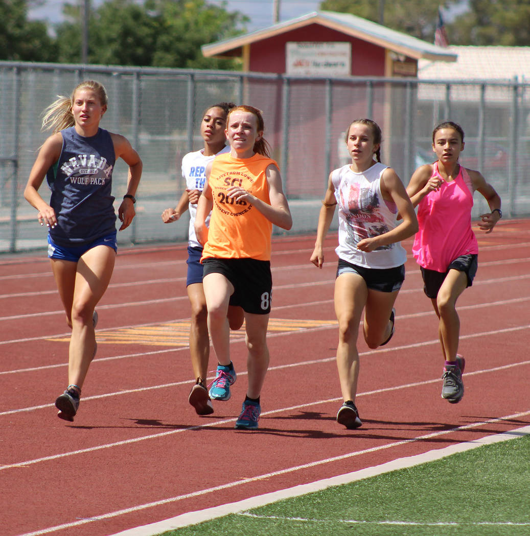 Tom Rysinski/Pahrump Valley Times Pahrump Valley High School girls track and field athletes get a workout in before the Class 3A state championships, which will be held Friday and Saturday at Cars ...