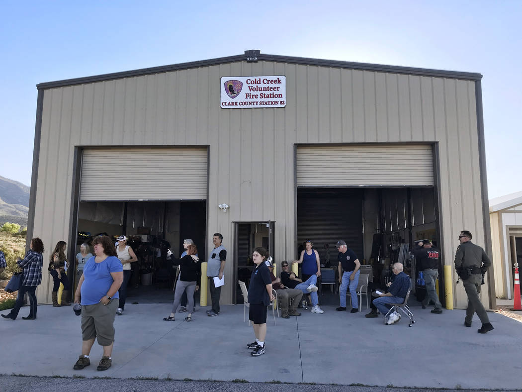 People wait outside the volunteer firehouse in Cold Creek Wednesday evening for the start of an informational meeting on an emergency wild horse roundup in the area. Henry Brean Las Vegas Review-J ...