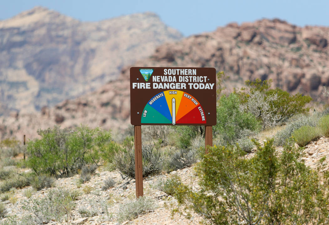 "The National Fire Danger Rating System is shown as ""high"" on a sign posted along State Route 159 at Red Rock National Conservation Area Friday, June 3, 2016, in Las Vegas. (Ronda Chu ..."