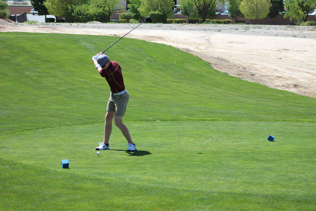 Tom Rysinski/Pahrump Valley Times Pahrump Valley sophomore Ian Kingsley tees off to open second-round play at the Class 3A state championship on Tuesday at Mountain Falls.