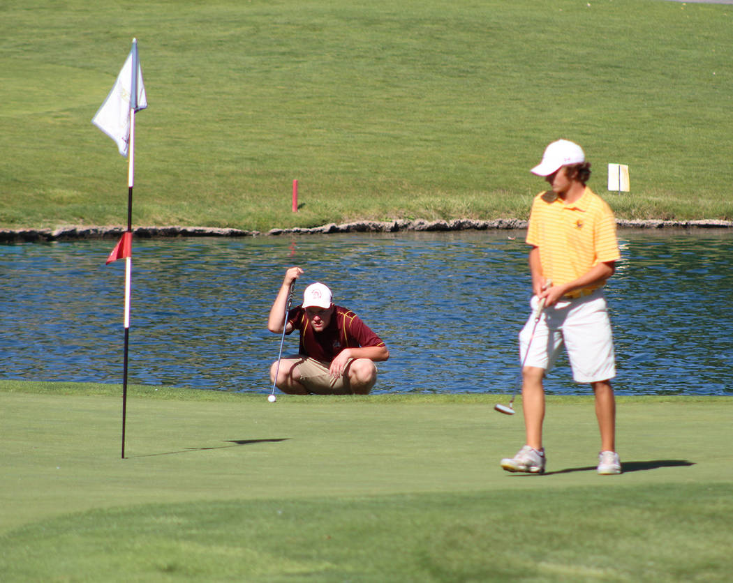 Tom Rysinski/Pahrump Valley Times Pahrump Valley sophomore Koby Lindberg lines up his putt as a Boulder City golfer waits his turn on the 18th green Tuesday during the Class 3A state championship ...