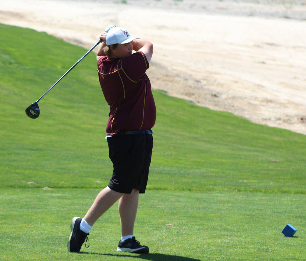 Tom Rysinski/Pahrump Valley Times Pahrump Valley senior Mike McDougall tees off to open his second round at the Class 3A state championship Tuesday at Mountain Falls. McDougall's two-day total of ...