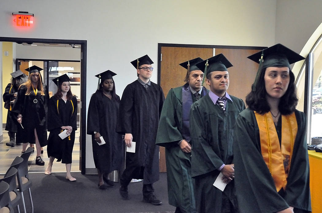 Horace Langford Jr./Pahrump Valley Times The 2018 graduates of Great Basin College are shown May 12 at Valley Electric Association's Conference Center in Pahrump. A total of 41 degrees and certif ...
