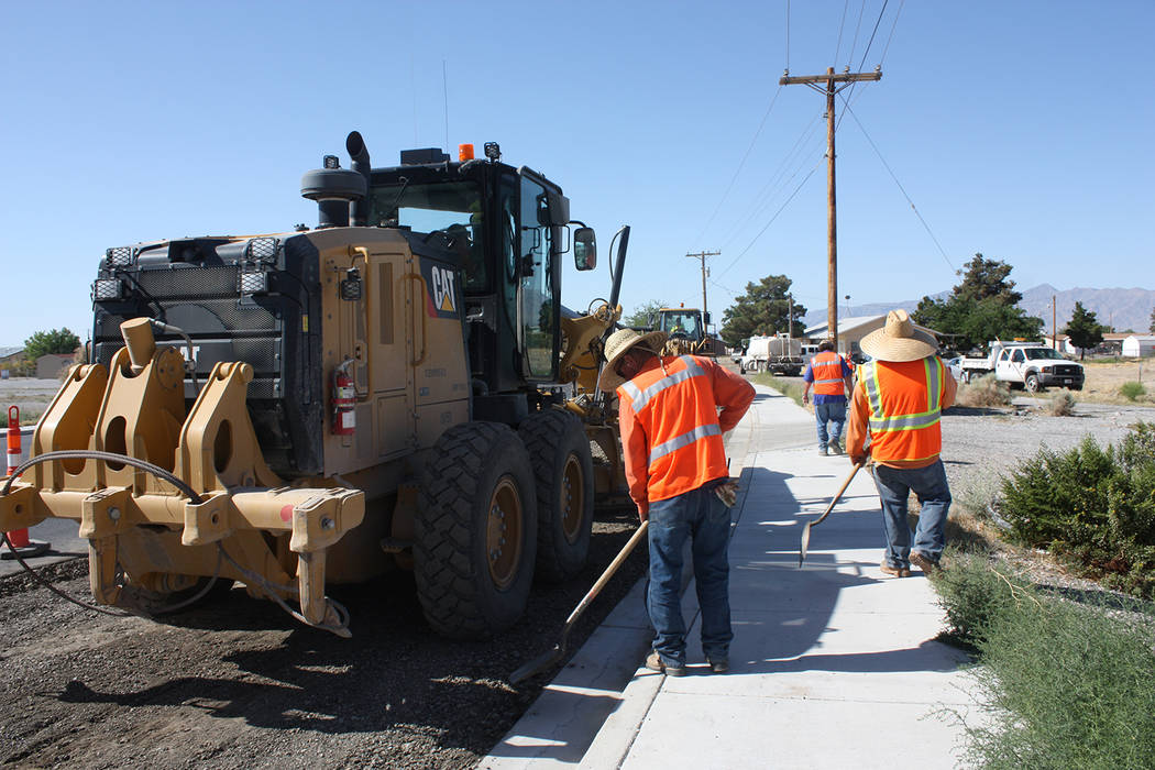 Robin Hebrock/Pahrump Valley Times Nye County Public Works crews were out on Homestead Road at the intersection of Hwy. 160 preparing for a layer of cold mix on Thursday, May 17. The cold mix is n ...