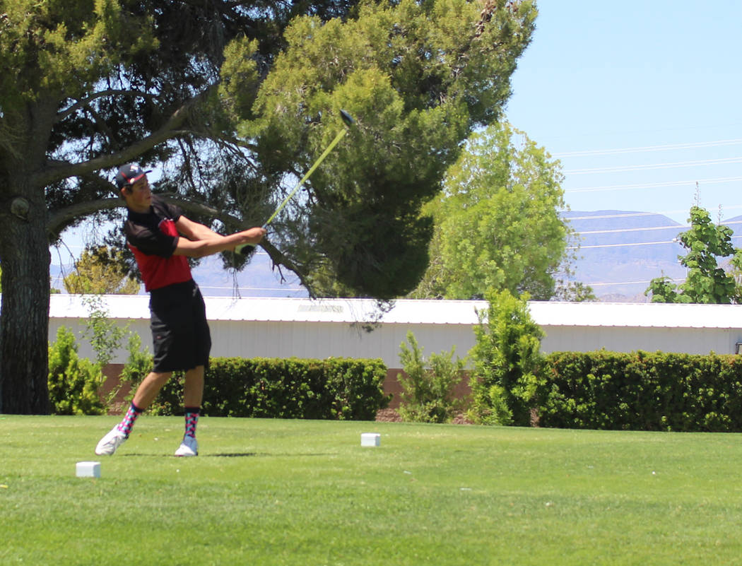 Tom Rysinski/Times-Bonanza & Goldfield News Sophomore Damian Paice of Tonopah tees off on the first hole to begin second-round play at the Class 2A state tournament May 17 at Boulder City Municipa ...