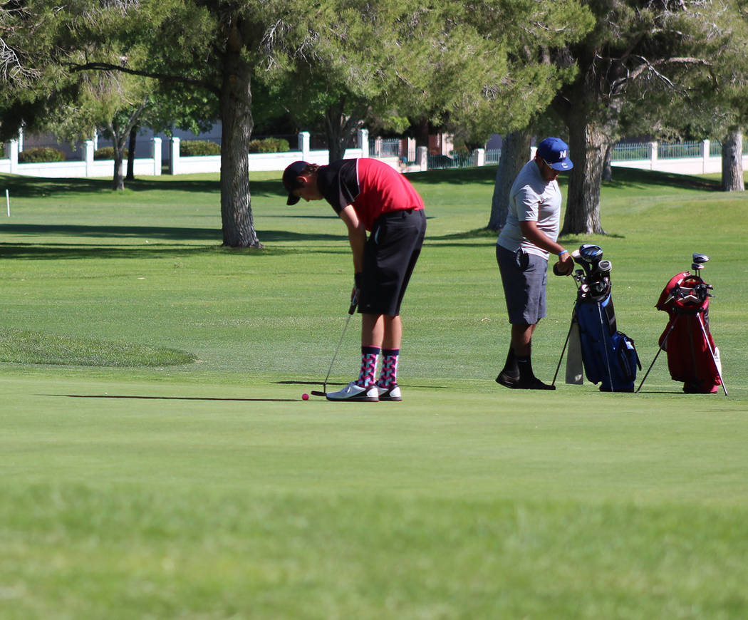 Tom Rysinski/Times-Bonanza & Goldfield News Tonopah junior Kevin Pope putts on the 18th green during the Class 2A state tournament May 17 at Boulder City Municipal Golf Course.
