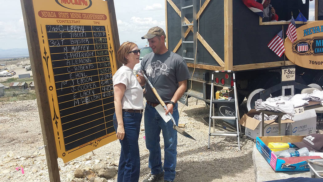 Dana Bennett, president of the Nevada Mining Association, left, chats with former Tonopah Town Manager James Eason on May 28. Bennett presented Eason an award for winning a mucking competition at ...