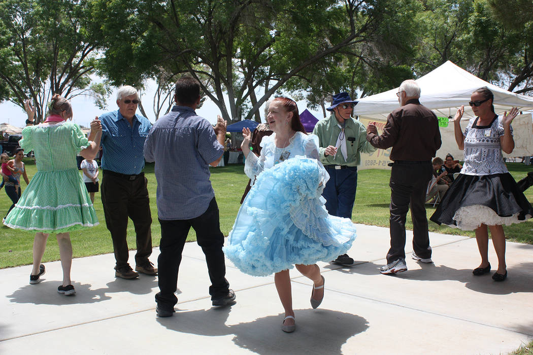 Robin Hebrock/Pahrump Valley Times The Desert Squares square dance group performed for the crowd at the 19th Art and Sol festival. The dancers were do-si-do-ing while Pahrump Arts Council Presiden ...
