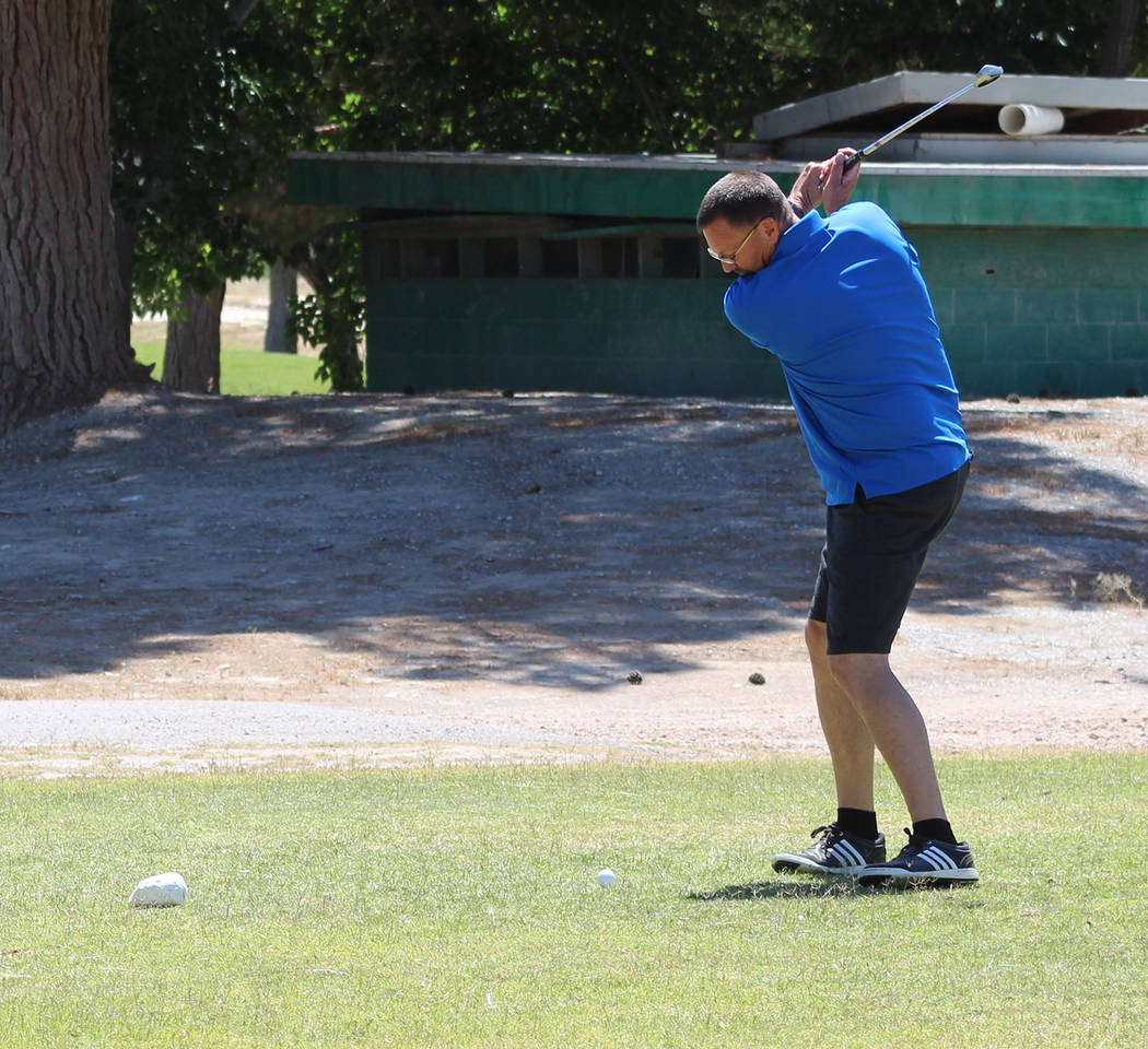 Tom Rysinski/Pahrump Valley Times Tony Carlo of Nevada Realty tees off on No. 10 during a fundraising tournament Saturday at Lakeview Executive Golf Course in Pahrump.