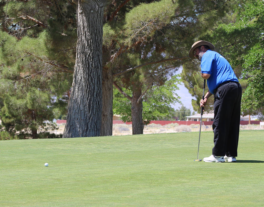 Tom Rysinski/Pahrump Valley Times Nye County Commissioner Dan Schinhofen watches the progress of his putt on the 10th green Saturday at Lakeview Executive Golf Course in Pahrump.