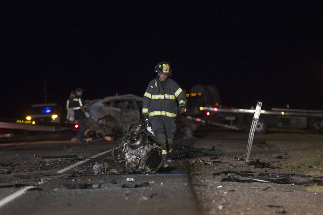 Workers at the scene of the multi-fatality crash on U.S. Highway 95, near Amargosa Valley in Nye County, Sunday, May 20, 2018. (Rachel Aston Las Vegas Review-Journal @rookie__rae)