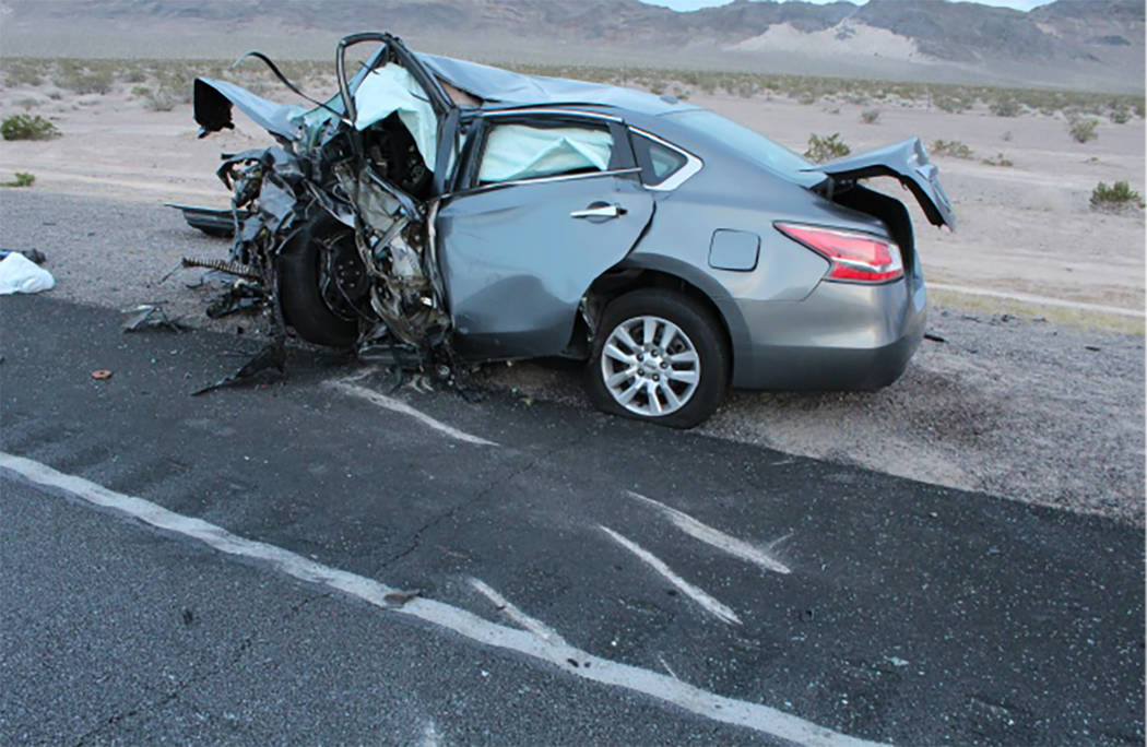 A vehicle is shown after a multi-fatality crash on U.S. Highway 95, near Amargosa Valley in Nye County, Sunday, May 20, 2018. (Nevada Highway Patrol)