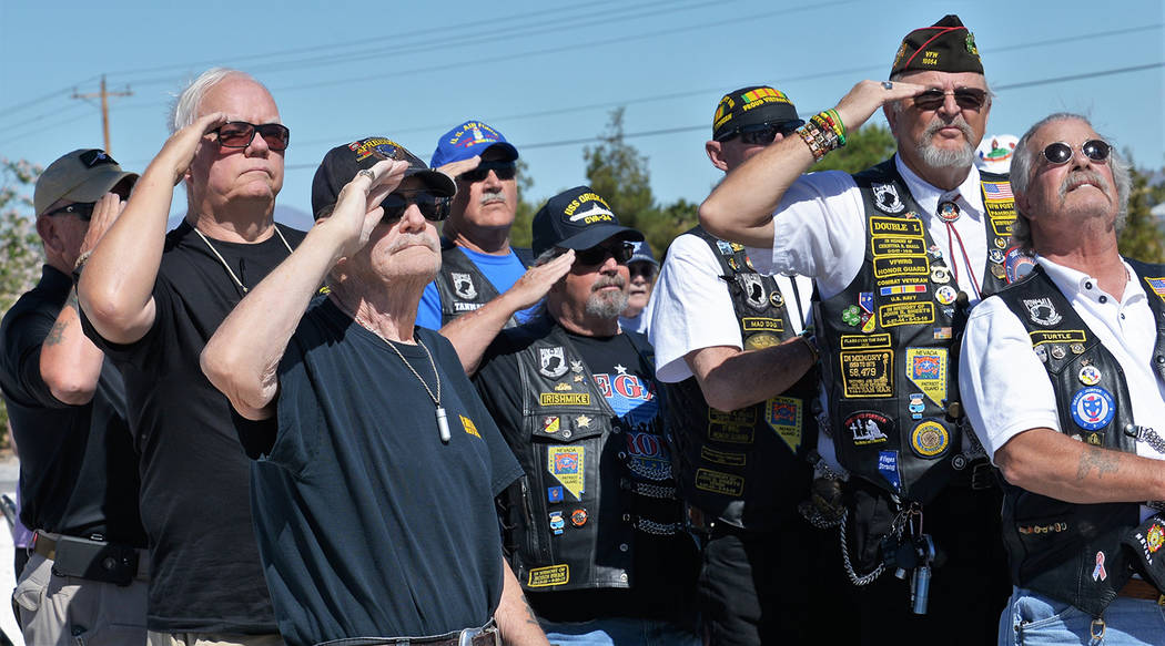 Selwyn Harris/Pahrump Valley Times Local veterans salute the flag during the G.G. Sweet Memorial Day service on Monday. The park, which is open to the public, is located at 1483 Gamebird Road.