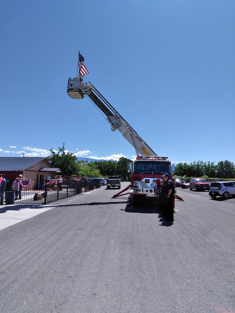 Selwyn Harris/Pahrump Valley Times Pahrump Valley Fire and Rescue Services Tower Ladder displayed the American flag during Monday's Memorial Day ceremony at the Pahrump Veterans Memorial.