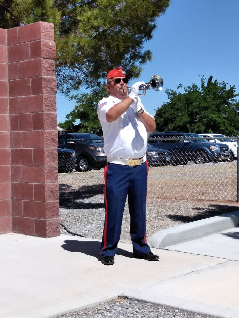 Selwyn Harris/Pahrump Valley Times A Pahrump Marine Corps League service member blows taps during Monday's ceremony. This year marks the first time the veteran group has organized a Memorial Day o ...