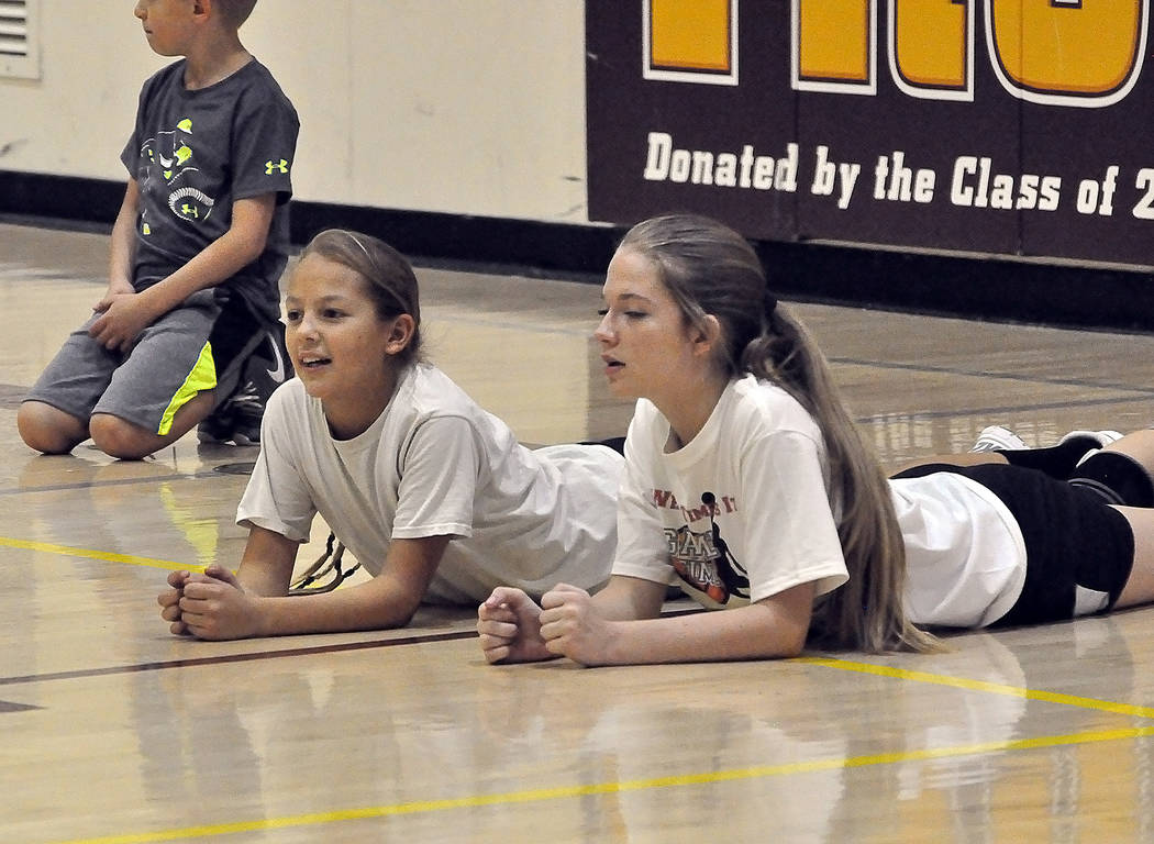Horace Langford Jr./Pahrump Valley Times Jazmine Aldana, left, and McKenna Robnett take a break during a session of Game Time Basketball Camp last June at Pahrump Valley High School.