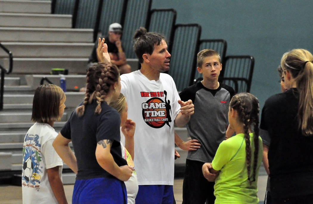 Horace Langford Jr./Pahrump Valley Times Gil Llewellyn talks with some of the aspiring players at his Game Time Basketball Camp in June 2016 at Rosemary Clarke Middle School in Pahrump.