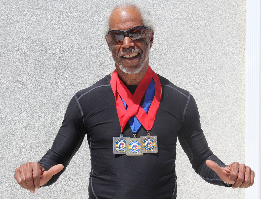 Tom Rysinski/Pahrump Valley Times Marvin Caperton of Pahrump shows off the one gold and two silver medals he won May 27 at the Bay Area Senior Games in San Mateo, California.