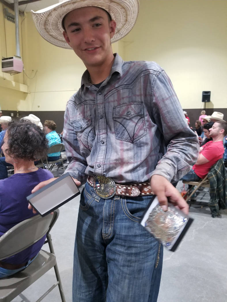 Buddy Krebs/Special to the Pahrump Valley Times Tye Hardy shows off the buckles he brought home from the Nevada High School Rodeo Association state finals. The junior from Pahrump will compete in ...