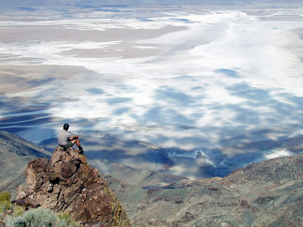 A park visitor enjoys the scenery from Dantes View in this undated photo. The overlook at Death Valley National Park has reopened after four months of renovations. (National Park Service)