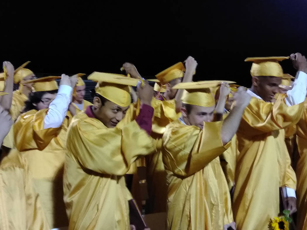 Selwyn Harris/Pahrump Valley Times Students turn their tassels from right to left after officially being declared graduating high school seniors, by Pahrump Valley High School Principal Jennifer E ...