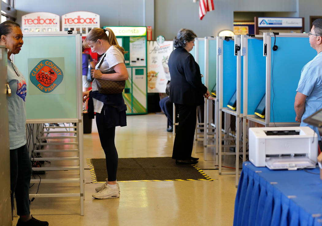 Chitose Suzuki/Las Vegas Review-Journal People cast their vote on the first day of early voting for Nevada's primary election at Albertsons at 10250 W. Charleston Blvd. in Las Vegas, Saturday, May ...