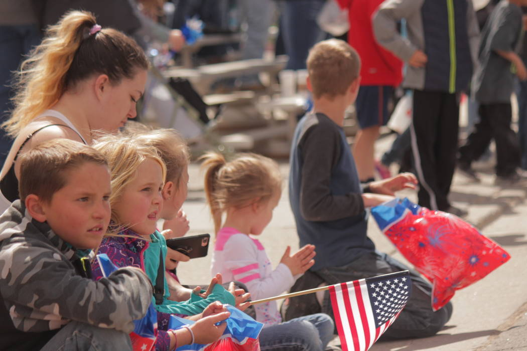 Jeffrey Meehan/Pahrump Valley Times Onlookers lined Main Street for the the parade at the Jim Butler Days in Tonopah on May 26, 2018. Hundreds watched as military organizations and others rolled ...