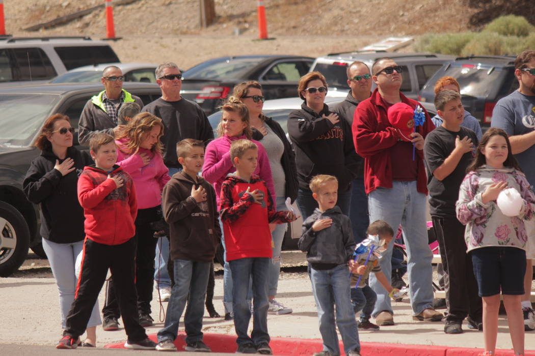 Jeffrey Meehan/Pahrump Valley Times The national anthem could be heard across Main Street on May 26, 2018. Onlookers lined the streets as young and old put their hands across their hearts.