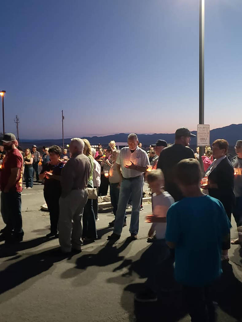 Esmeralda County Sheriff's Office A crowd gathers at a candlelight vigil for Nye County Sheriff's Sgt. Duane Downing on Monday, May 28 in Tonopah. Downing was injured while directing traffic at a ...