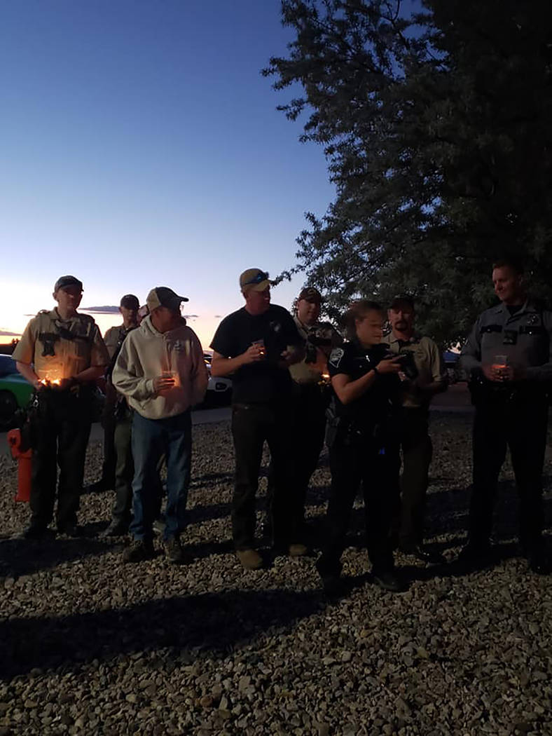 Esmeralda County Sheriff's Office Law enforcement officers gather at a candlelight vigil for Nye County Sheriff's Sgt. Duane Downing on Monday, May 28 in Tonopah. Downing was struck by a vehicle o ...