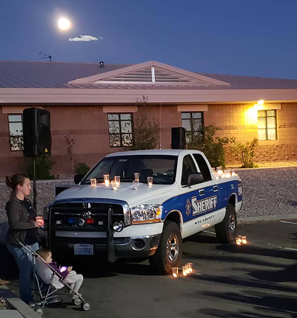 Esmeralda County Sheriff's Office Candles illuminate Nye County Sheriff's Sgt. Duane Downing's sheriff's pickup truck at a vigil held Monday, May 28 in the town of Tonopah. Downing was injured a w ...