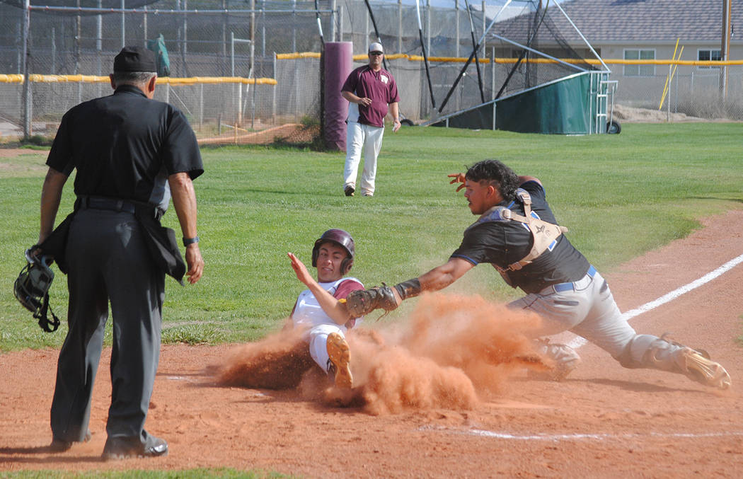 Charlotte Uyeno/Pahrump Valley Times Garrett Lucas is tagged out in a cloud of dust during a regular-season game against Desert Pines. The Pahrump Valley senior's 27 runs scored were second on the ...