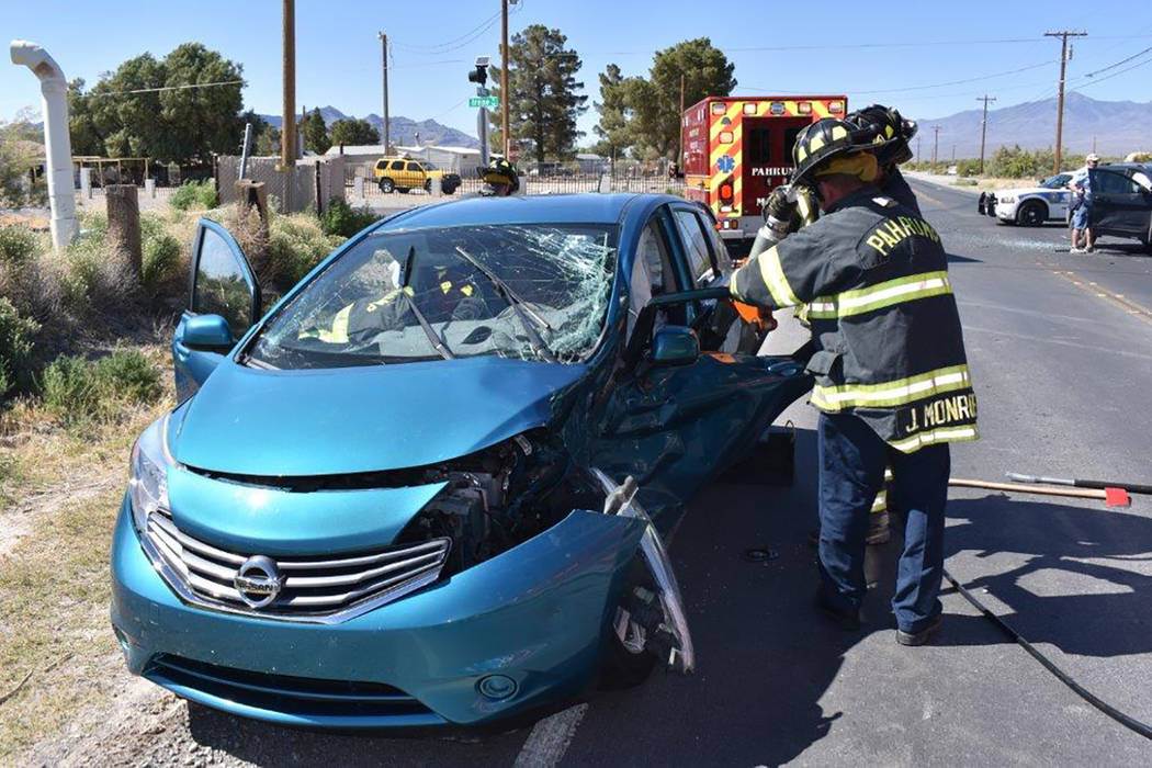Special to the Pahrump Valley Times Fire crews were forced to perform a door removal to free an entrapped driver after a two-vehicle crash along North Blagg Road at Irene Street on Friday May 25. ...